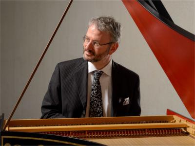 Byron Schenkman playing a harpsichord